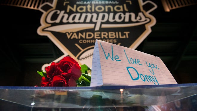 Flowers and a sign were left near the front gate by fans in memory of Vanderbilt pitcher and Clarksville native Donny Everett before a NCAA Regional baseball game between Vanderbilt and Xavier at Hawkins Field, Friday, June 3, 2016, in Nashville, Tenn.