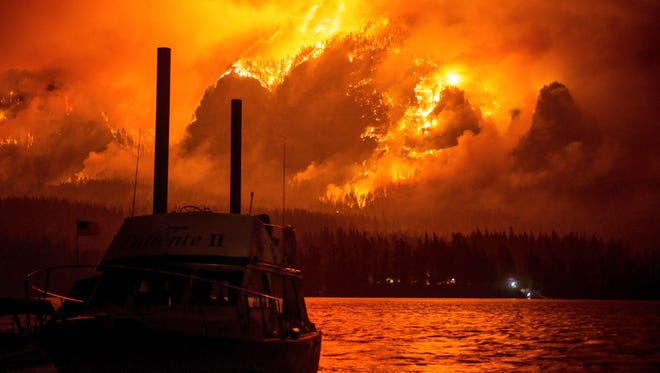 This photo provided by KATU-TV shows the Eagle Creek wildfire as seen from Stevenson Wash., across the Columbia River, burning in the Columbia River Gorge above Cascade Locks, Ore., on Monday Sept. 4, 2017. Wildfire smoke is especially dangerous to people with chronic heart and lung problems, said Julie Fox, an environmental epidemiologist with the Washington State Department of Health. The smoke is a combination of several toxins, and its tiny particles can be inhaled deeply into the lungs, she said.