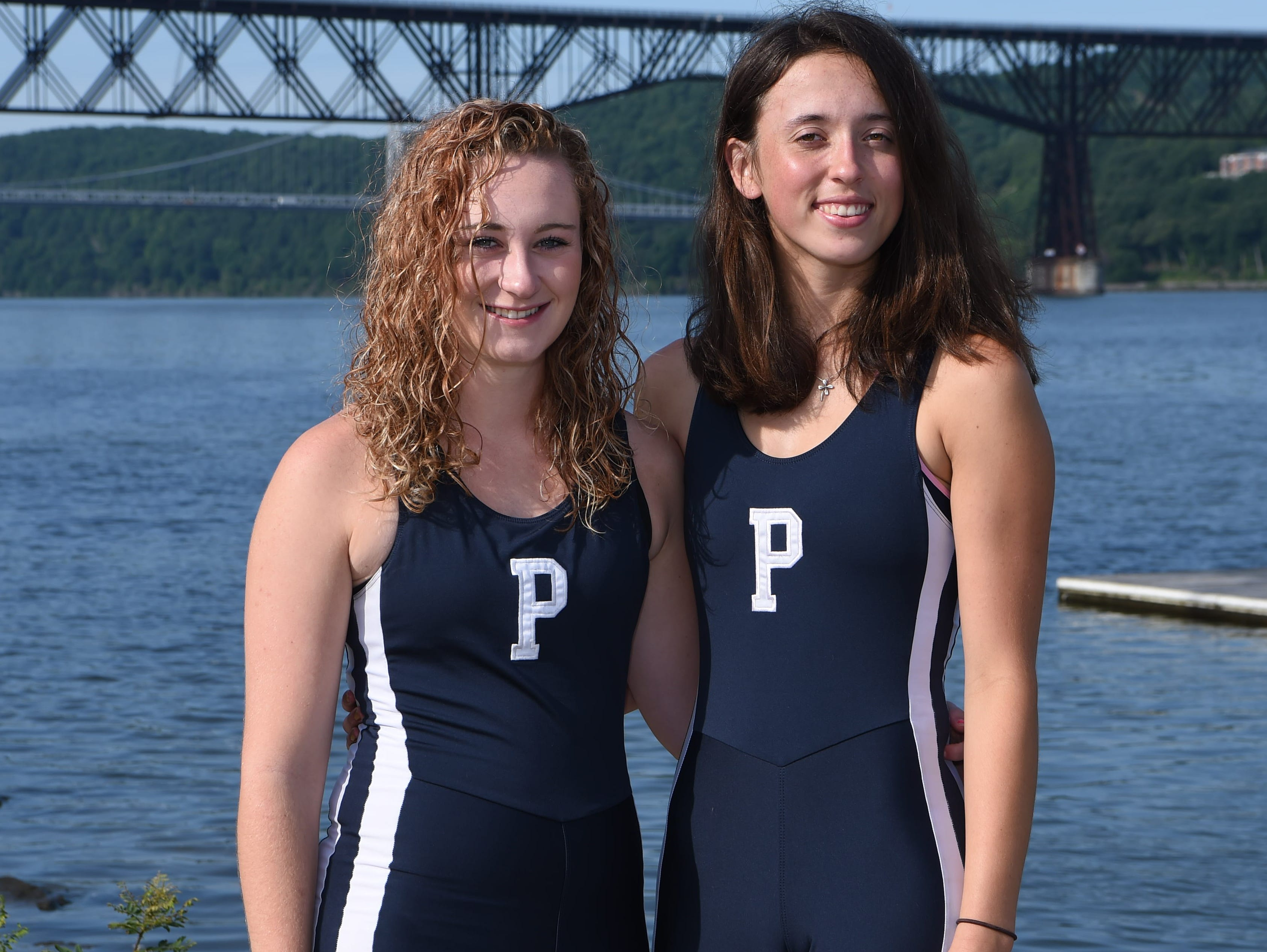 Devin Tully, left, 18, and Fiona Mauer, right, 17, both from the City of Poughkeepsie and graduates of Poughkeepsie High School, pose on the Hudson River. They make up the Girls Crew Boat of the Year.