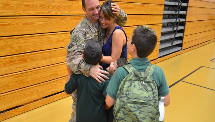 Air Force dad surprises 3 sons at school after his 6-month deployment in Afghanistan