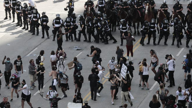 Columbus police attempt to move a crowd of protesters from the intersection of Broad and High streets on May 30, 2020, following the death of George Floyd  by Minneapolis police.