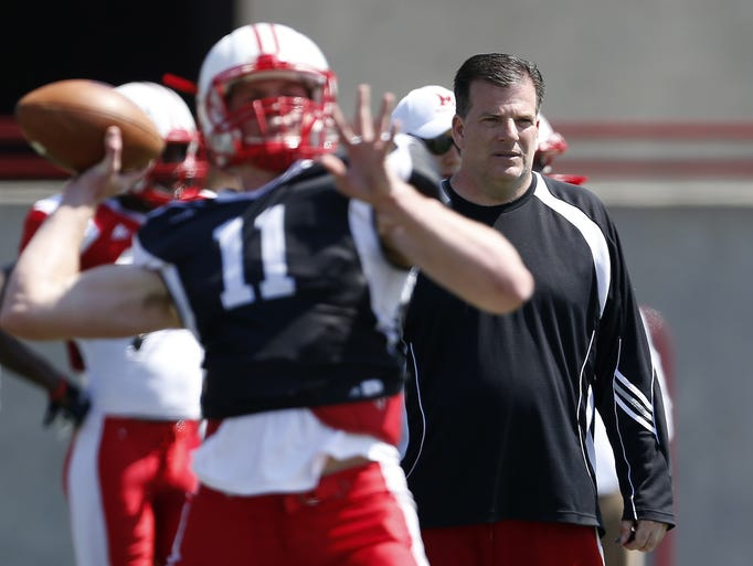 Miami University head football coach Chuck Martin works with his team during practice at Yager Stadium
