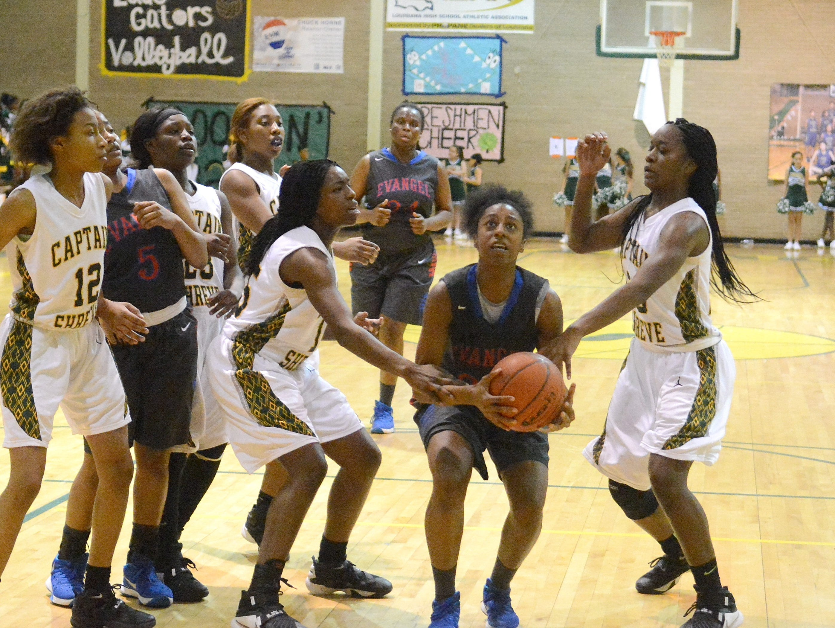 Evangel's Tiara Young goes up for a shot against Captain Shreve this past season.