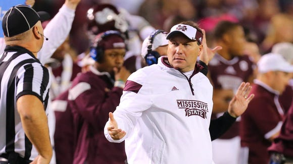 Nov 22, 2014; Starkville, MS, USA; Mississippi State Bulldogs head coach Dan Mullen reacts during the game against the Vanderbilt Commodores at Davis Wade Stadium.   Mandatory Credit: Spruce Derden-USA TODAY Sports