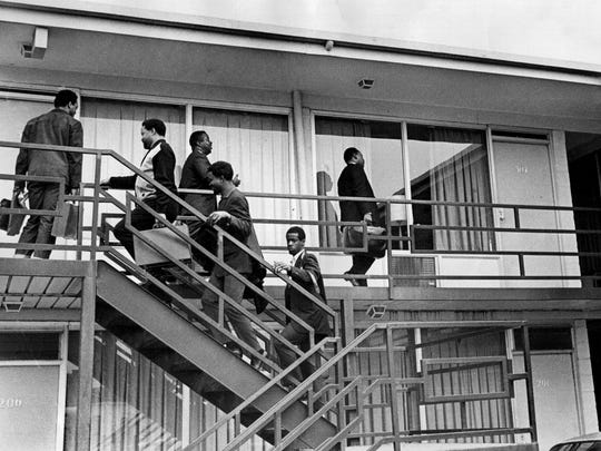 Dr. Martin Luther King Jr. (at right on balcony) followed by his aides Ralph Abernathy, Jesse Jackson, Hosea Williams and two unidentified men at the Lorraine Motel Wednesday afternoon, April 3, 1968.