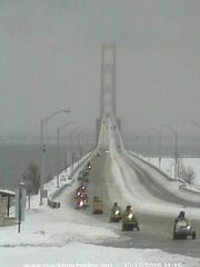 Vintage snowmobiles crossed the bridge 39 strong last