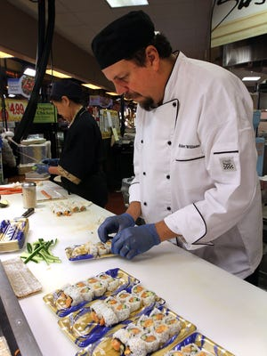 A chef at Wegmans Woodbridge store in a 2014 file photo.