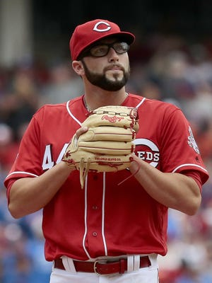 Cincinnati Reds starting pitcher Cody Reed (44) pounds his glove in frustration after Chicago Cubs left fielder Albert Almora Jr. (5) hit a home run to right-center field in the top of the fourth inning of the MLB National League game between the Cincinnati Reds and the Chicago Cubs at Great American Ball Park on Wednesday, June 29, 2016. The Reds fell 9-2 to the Cubs for loss No. 50 of the season.