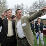 Tom Gendron, Woodward, Inc.'s CEO and Chairman of the Board, left, and Colorado Gov. John Hickenlooper look over the grounds of Woodward's campus on Lincoln Avenue during groundbreaking for its new industrial turbomachinery systems building in Fort Collins.