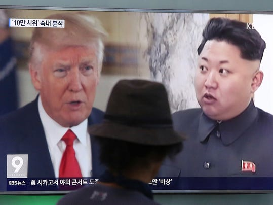 FILE - In this Aug. 10, 2017, file photo, a man watches a TV screen showing U.S. President Donald Trump, left, and North Korean leader Kim Jong Un during a news program at the Seoul Railway Station in Seoul, South Korea. South Korea is one of the safest places in the world to live and visit. But it's also an easy drive to the edge of an incredibly hostile, and nuclear-armed, North Korea. Since U.S. President Donald Trump has begun matching the over-the-top rhetoric North Korea has always favored, there have been worries over the possibility of war. (AP Photo/Ahn Young-joon, File)