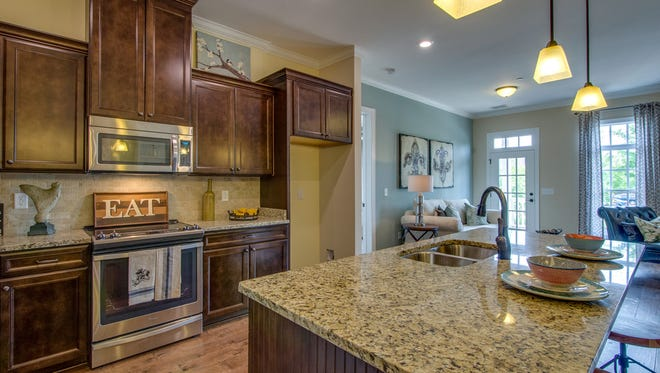 An energy efficient kitchen built by Regent features Energy Star appliances and lighting.