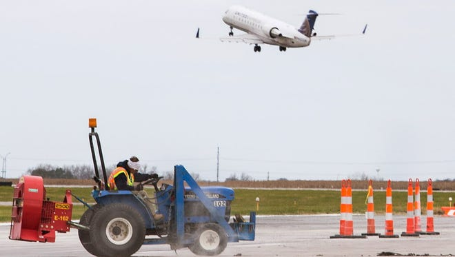 Construction continues Oct. 27 on a runway at Lincoln Airport in Nebraska as a United Airlines flight takes off.