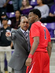 Fresno State coach Rodney Terry talks with guard Jaron Hopkins during the first half against TCU in the first round of an NCAA college basketball game in the NIT, in Fort Worth, Texas, Wednesday, March 15, 2017. (Paul Moseley/Star-Telegram via AP)
