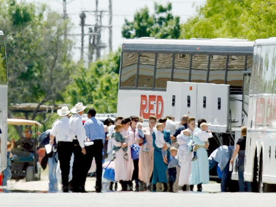 San Angelo police wait to escort buses loaded with