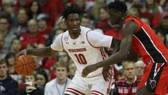 Badgers forward Nigel Hayes moves the ball against