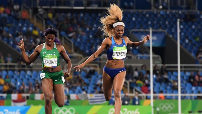 Former New Rochelle High star Deajah Stevens (USA), right,finished third in her heat Tuesday night to advance to the final of the women's 200 meters Wednesday night in the Rio 2016 Summer Olympic Games at Estadio Olimpico Joao Havelange.