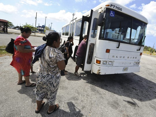 In this file photo, riders board a Guam Regional Transit Authority bus. Significant investment into the mass transit system is needed.