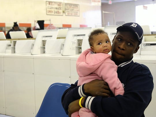 """Deris and his baby daughter in the documentary """"Street"""