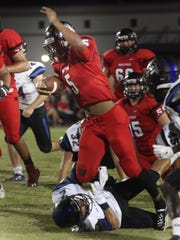 South Fort Myers' FaNajae Gotay is tackled by Ida Baker's Josh Keller during a game at South Fort Myers on Friday night.