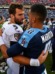 Ravens quarterback Joe Flacco (5) and Titans quarterback