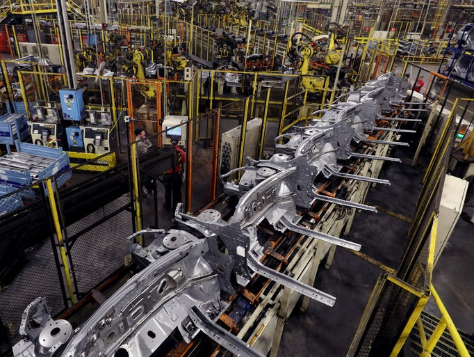 Robots work on the production of Nissan vehicles at