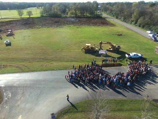 Students and public officials watched a groundbreaking