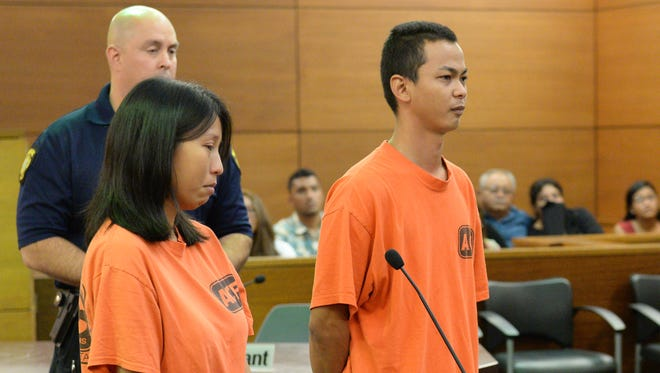 Victoria Siaotong, left, appears to be near tears as Shawn Cruz, right, asked the judge for permission to attend the rosary of their 3-month-old son, Tyler Cruz, during their magistrate hearing at the Superior Court of Guam on Aug. 6, 2014.