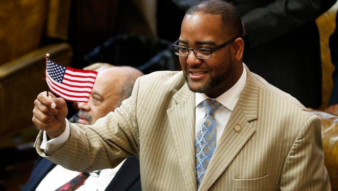 Rep. Orlando Paden, D-Clarksdale, waves a small American flag as the Mississippi Legislature ended its 2017 regular session Wednesday at the Capitol in Jackson. However lawmakers will have to return later to pass budgets for the attorney general's office and the Department of Transportation.