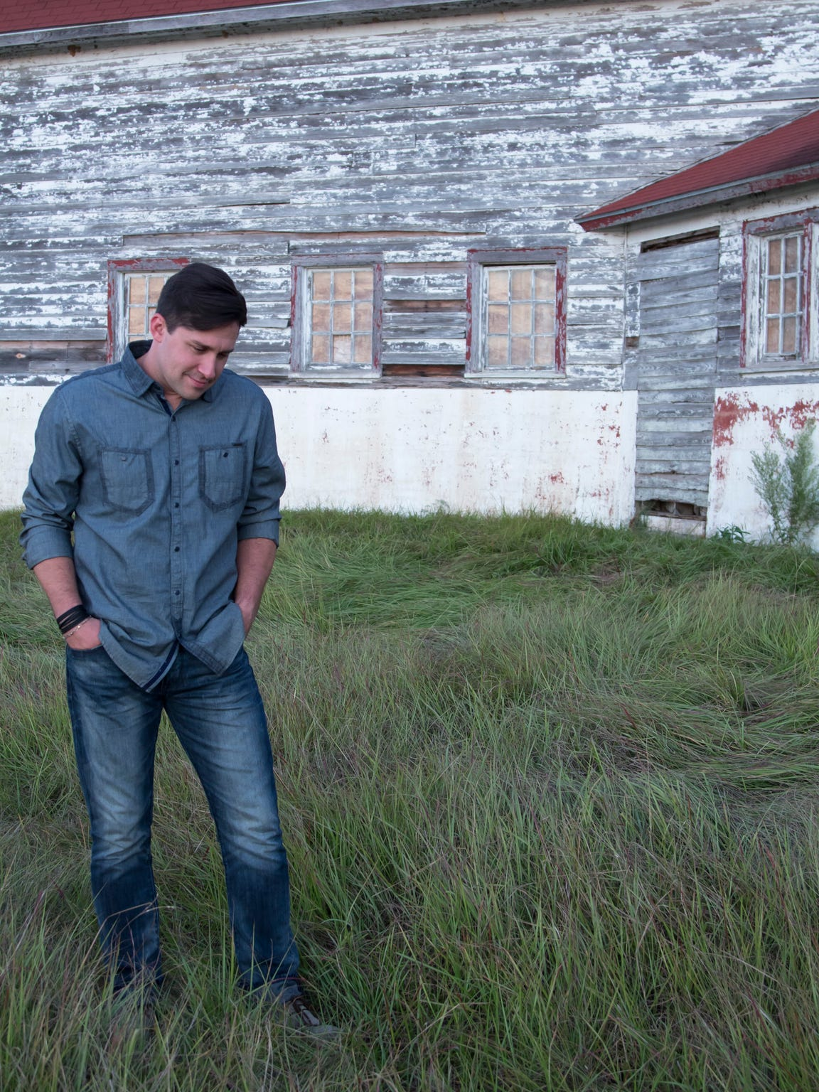 For Josh Blakesley, shown in a contemplative mood at the old dairy barn near Fort Buhlow in Pineville, tragedy is at the roots of his Christian music ministry.