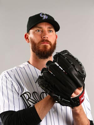 Colorado Rockies pitcher John Axford poses for a portrait during photo day at Salt River Fields.
