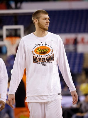 Northern Iowa's Seth Tuttle warms up before the college all-star game at the NCAA Final Four college basketball tournament basketball Friday, April 3, 2015, in Indianapolis. (AP Photo/David J. Phillip)