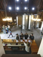 Tastings take place amid wine tanks at Hermann J. Wiemer Vineyard in Dundee, Yates County.