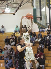 Northwest's Christian Choice (20) goes up for a dunk