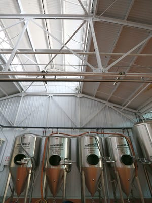 The four fermentation vessels currently used at the new Triphammer Bierwerks in Fairport.