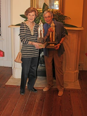 Joan Loeb, left, and Mary Ann Neeley hold the James Lucian Loeb and Mary Ann Neeley Awards, respectively, during the Raise the Glass to the Past reunion at Ware Farley Hood House in Old Alabama Town.