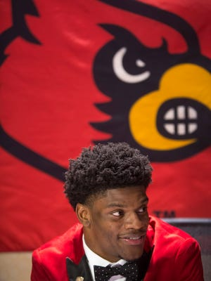 Louisville quarterback Lamar Jackson, left was all smiles during a press conference prior to the Heisman Trophy announcement. Jackson is the favorite to win the award. Dec. 10, 2016