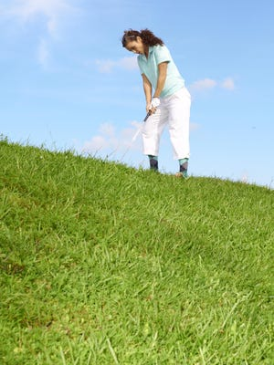 Properly hitting a downhill lie can be tricky.