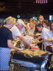 Guests dig in to Low country boil catered by Osceola