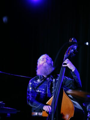 Rex Horan plays bass with the Neil Cowley Trio at Christ Church during the Xerox Rochester International Jazz Festival.