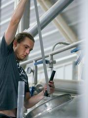 Zachary Allard, lead brewer, works on the Munich Dunkel