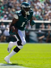 Eagles wide receiver Nelson Agholor runs down the sideline after making a reception against the New York Giants on Sept. 24.