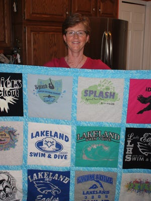 One lucky bidder at Five Points of Hope's annual fundraiser will win a personalized quilt by Lisa Philip, owner of Blankets by Design in Highland township. Philip shows a quilt she made for her daughter.