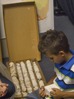 Above: Kage Faison examines core samples from South Florida during Earth Science Week.