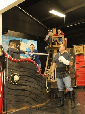 """Members of St. Mary School's Drama Department rehearse a scene from their production of Disney's """"Peter Pan Jr."""""""