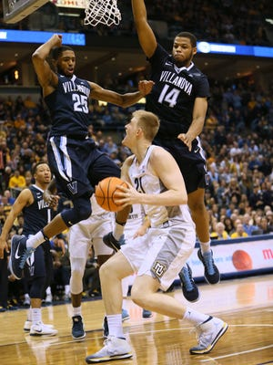 Marquette sophomore center Harry Froling goes up for a shot against Villanova on Sunday.