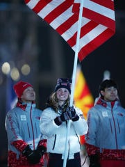 Flag bearer Jessica Diggins from Stratton, Vt., participates in the Parade of Athletes during the closing ceremony of the PyeongChang 2018 Winter Olympic Games in South Korea.