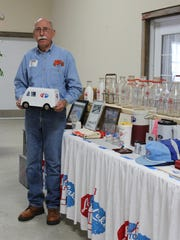"""John Poch shares his extensive collection of Lake to Lake Dairy Cooperative memorabilia during the """"Our Dairy Past"""" program at the Agricultural Heritage and Resource Center in Kewaunee on May 19."""