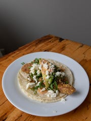 Tortilla shells are doubled up in this fish taco recipe to more sturdily hold all the ingredients.