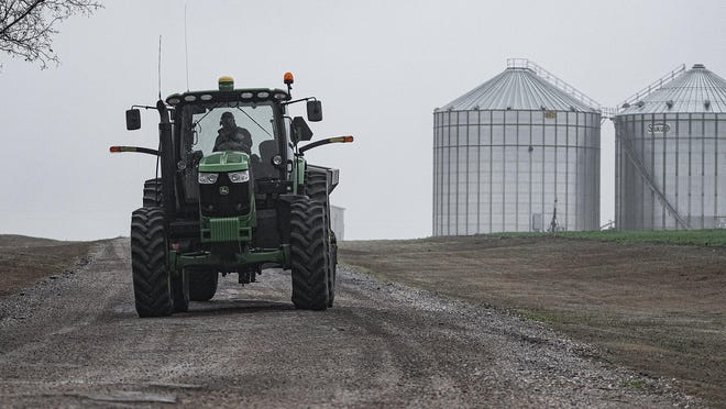 Coupland farmer John Prinz navigates a tractor on his family's land in January. Numerous Texas companies manufacture and supply parts for tractors and other heavy machinery that keep businesses humming.