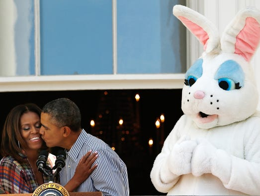 President  Obama kisses first lady Michelle Obama at the annual White House Easter Egg Roll on April 21.